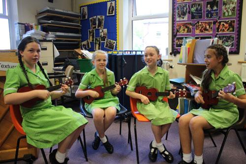 Girls playing ukulele