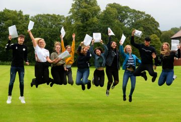 Students jump for joy at this year's GCSE results.