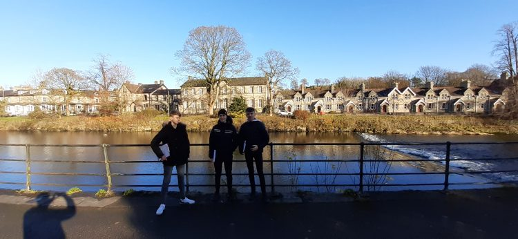 Year 12 Westholme pupils stand next to river in Cumbria whilst on Geography Field Trip