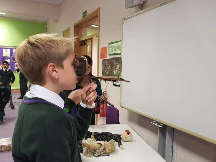 Westholme student looks through lens during interactive history lesson