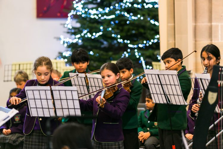 Members of Westholme junior school orchestra play at the junior school carol service in Blackburn Cathedral