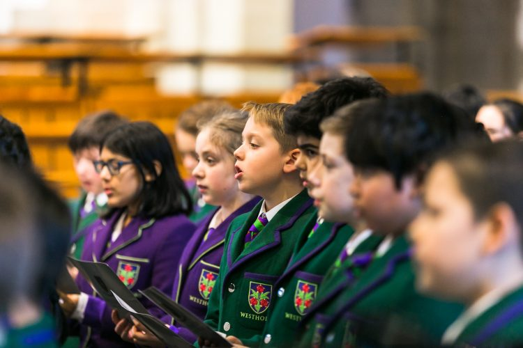 Members of Westholme junior school sing at their carol service in Blackburn Cathedral