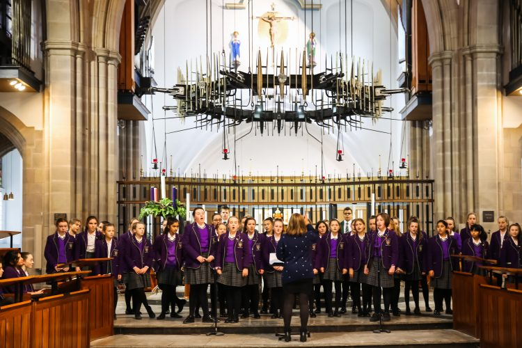 Choir master leads the choir who sing at the Westholme senior school carol service in Blackburn Cathedral