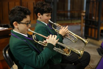 Two senior school pupils play the trumpet at the Westholme carol service in Blackburn Cathedral