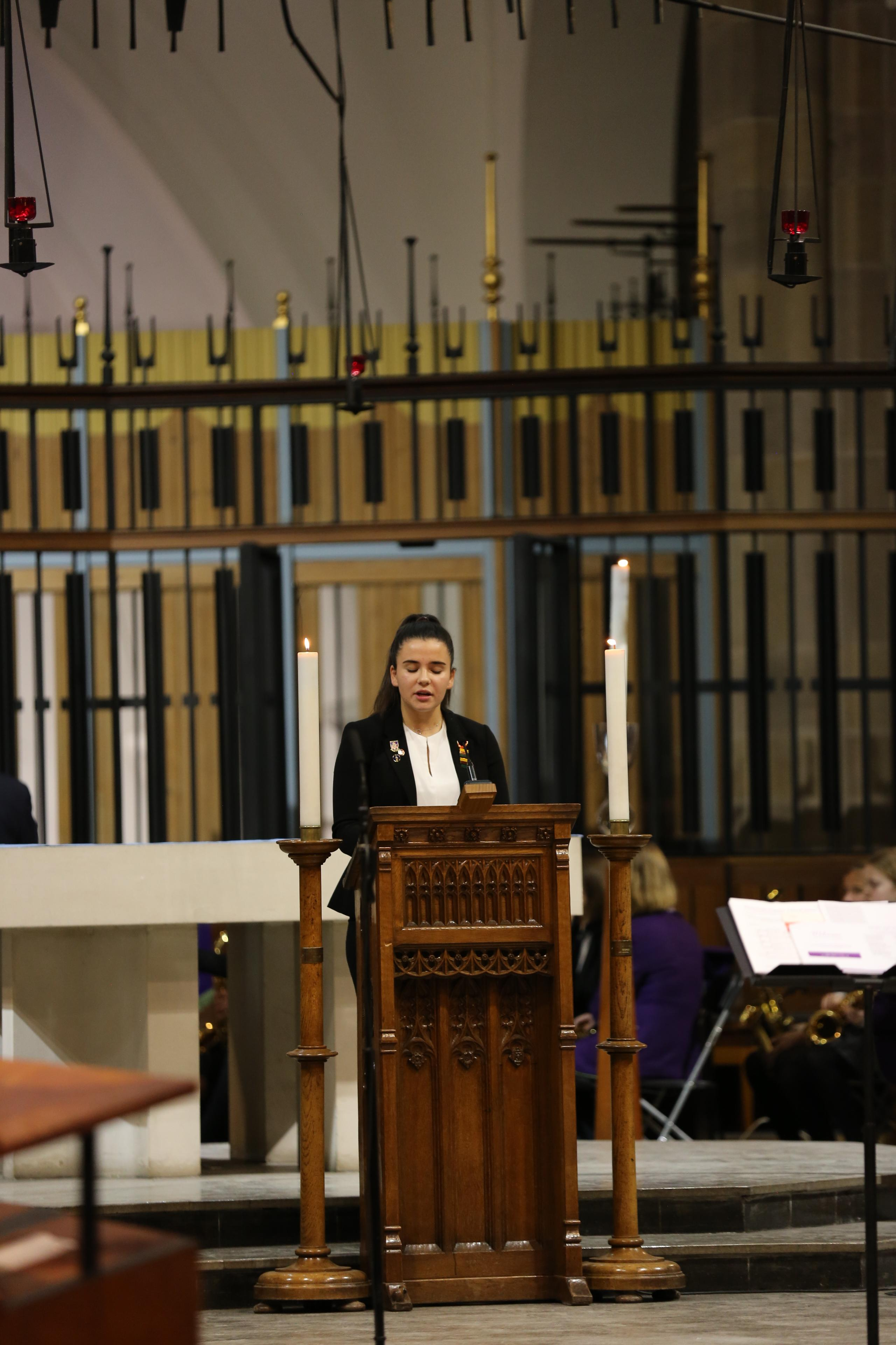 Westholme senior school student performs a reading during the carol service at Blackburn Cathedral