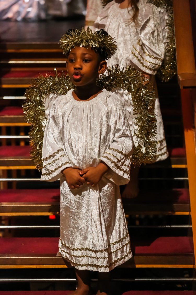 Pupil sings dressed as angel at Westholme Nursery and Infant school nativity play