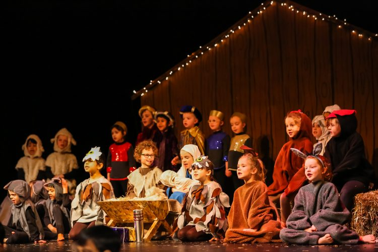 Mary, Joseph, the baby Jesus and visitors in the barn at the Westholme Nursery and Infant school nativity play