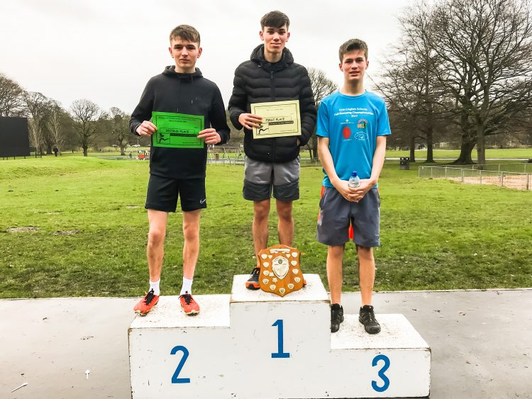 Boys of Westholme sixth form stand on trophy podium after winning cross country race