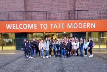Westholme students stand outside Tate Modern in London on a school trip