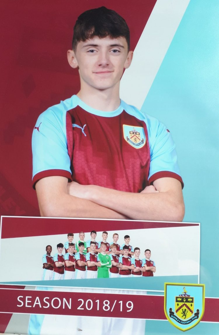 Westholme year 11 pupil Will Couch poses in Burnley FC kit for the 2018/19 season
